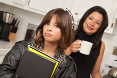 Pretty Hispanic Girl Ready for School with Mom Royalty Free Stock Photo