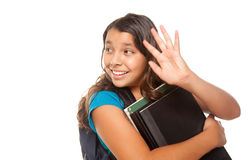 Pretty Hispanic Girl Waving with Books and Backpac. K Ready for School Isolated on a White Background Stock Photography