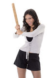 Pretty hispanic lady with a baseball bat, studio Royalty Free Stock Photography