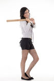Pretty hispanic lady with a baseball bat, studio Stock Photo
