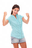 Pretty hispanic lady in blue shirt with arms up Stock Photography