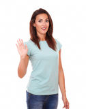 Pretty hispanic lady with greeting hand Stock Image