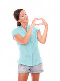 Pretty hispanic lady looking at a love sign Stock Photography