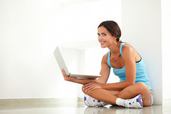 Pretty hispanic lady surfing on her computer Stock Photography