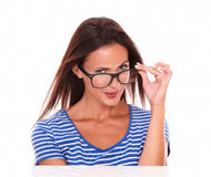 Pretty hispanic smiling and wearing spectacles Stock Images
