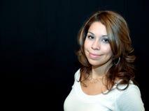 Pretty Hispanic Woman. Hispanic woman smiling on black Royalty Free Stock Images