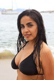 Pretty hispanic woman on beach in Mexico Royalty Free Stock Photography