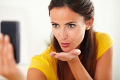 Pretty hispanic woman blowing a kiss Stock Photography