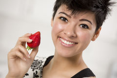 Pretty Hispanic Woman Holding Strawberry Stock Photography