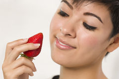 Pretty Hispanic Woman Holding Strawberry Stock Images