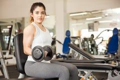Pretty Hispanic woman lifting weights royalty free stock photos