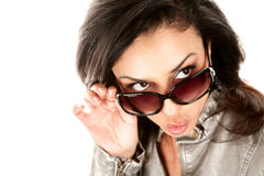 Pretty Hispanic woman looking over her glasses Stock Images