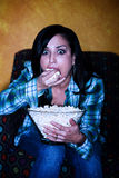 Pretty Hispanic woman with popcorn Royalty Free Stock Image