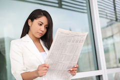 Pretty Hispanic Woman Reading Newspaper Royalty Free Stock Image