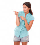 Pretty hispanic woman in short jeans pointing Royalty Free Stock Photo