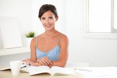 Pretty hispanic woman studying her books Royalty Free Stock Photos