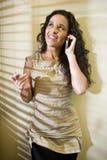 Pretty Hispanic woman talking on a mobile phone Royalty Free Stock Image
