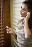 Pretty Hispanic woman talking on a mobile phone Royalty Free Stock Photography