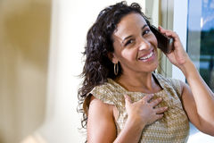 Pretty Hispanic woman talking on a mobile phone Royalty Free Stock Images