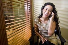 Pretty Hispanic woman talking on a mobile phone Royalty Free Stock Photo
