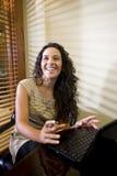 Pretty Hispanic woman using laptop computer Royalty Free Stock Image