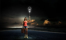 Pretty hitchhiking girl Royalty Free Stock Image