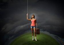Pretty hitchhiking girl Stock Photo