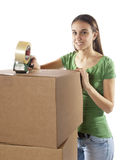 Pretty homemaker packing to move to new house. Royalty Free Stock Photography