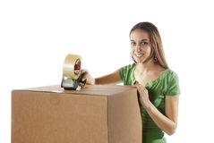Pretty homemaker packing to move to new house. Stock Image