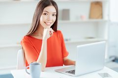 Pretty hopeful woman working at home stock images
