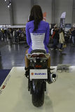 Pretty hostess sitting on a motorcycle. 11th Car and Motorcycle Tuning Show in Hungexpo, Budapest, Hungary. Photo taken to: March 19th, 2016 Royalty Free Stock Photography