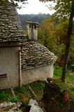 Pretty house in Dolomites with a rock roof with green moss royalty free stock photo