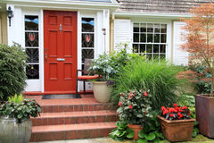 Pretty house and garden. Pretty front door and landscaped front garden. Photo taken from the public sidewalk stock image
