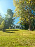 Pretty house on a hill. With birch tree Stock Photo