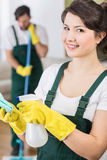 Pretty housekeeping woman ready to clean Royalty Free Stock Photography