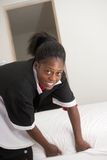 Pretty housemaid in uniform Royalty Free Stock Photo