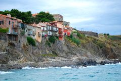 Pretty houses built into the cliffs at Collioure. In the south of France Royalty Free Stock Images