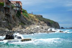 Pretty houses built into the cliffs at Collioure. In the south of France Royalty Free Stock Image