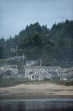 Pretty houses near sea in state Oregon. Beautiful buildings near Cannon Beach in USA with trees on background Royalty Free Stock Photography