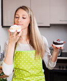 Pretty housewife in apron with cakes Stock Images