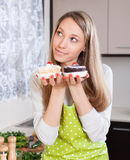 Pretty housewife in apron with cakes Stock Photography