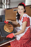 Pretty housewife baking bread Stock Image