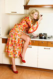 Pretty housewife cooking dinner Royalty Free Stock Images