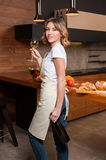 Pretty Housewife in the kitchen with glass of wine Royalty Free Stock Images