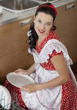 Pretty housewife in the kitchen Royalty Free Stock Images