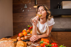 Pretty Housewife lying on the table with glass of wine Royalty Free Stock Photo