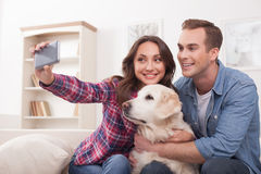 Pretty husband and wife with cute puppy Royalty Free Stock Photo