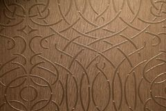 Beautiful background image of gold foil wallpaper with scroll design. Pretty image of gold foil wallpaper with scrollwork design in home Royalty Free Stock Image