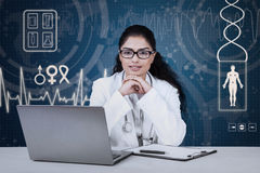 Pretty indian doctor with medical background Stock Images