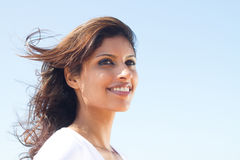 Pretty indian girl. Portrait of a pretty indian girl on blue sky background Stock Photography